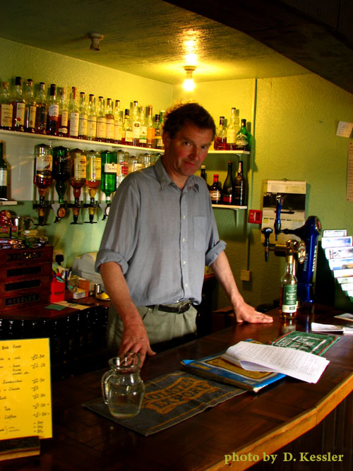 Mike, behind the bar of the Crask