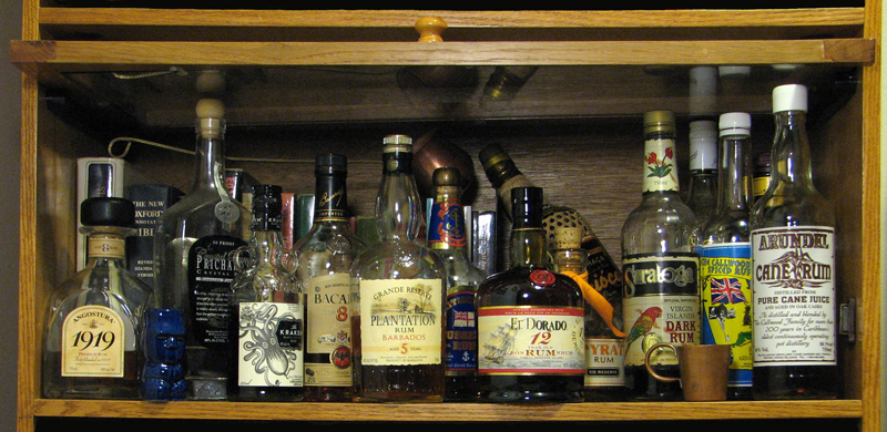 a bookcase with rum